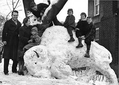 Family fun building snow sculpture